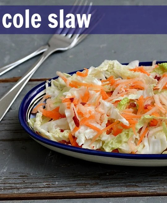 This healthy cole slaw is the perfect side dish any time of year. It's healthier than the traditional mayonnaise-laden version you get at the diner.