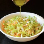 This ginger lime Asian slaw is a delicious vegan side dish.