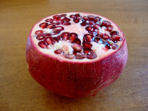 Pomegranate seeds are delicious in this tropical yogurt parfait recipe.