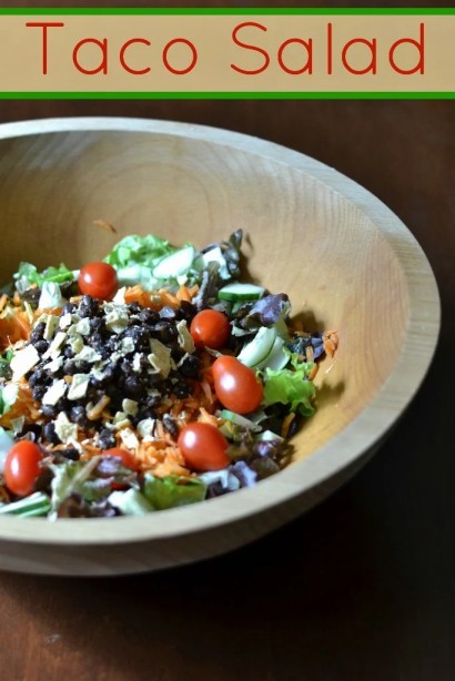 This taco salad is a healthy, kid-friendly dinner that's perfect for a warm summer night. It's full of fresh produce and beans.