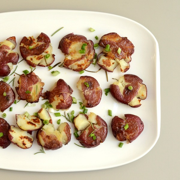 These smashed potatoes are a delicious, easy side dish that goes with lots of different meals. Try this healthy recipe to dress up your potatoes.