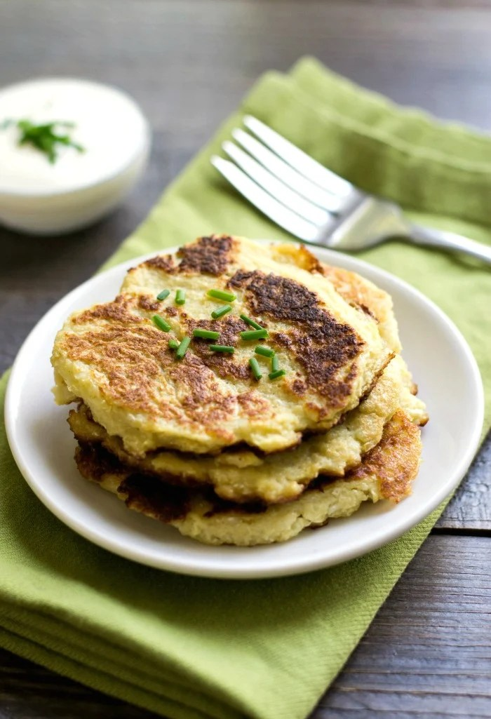 These cauliflower pancakes are a savory side dish that even a cauliflower skeptic will enjoy! This is a healthy, delicious, gluten free recipe that goes well with lots of different main dishes.