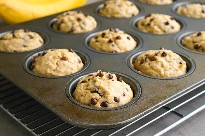 These banana oat muffins cool in the pan before eating.