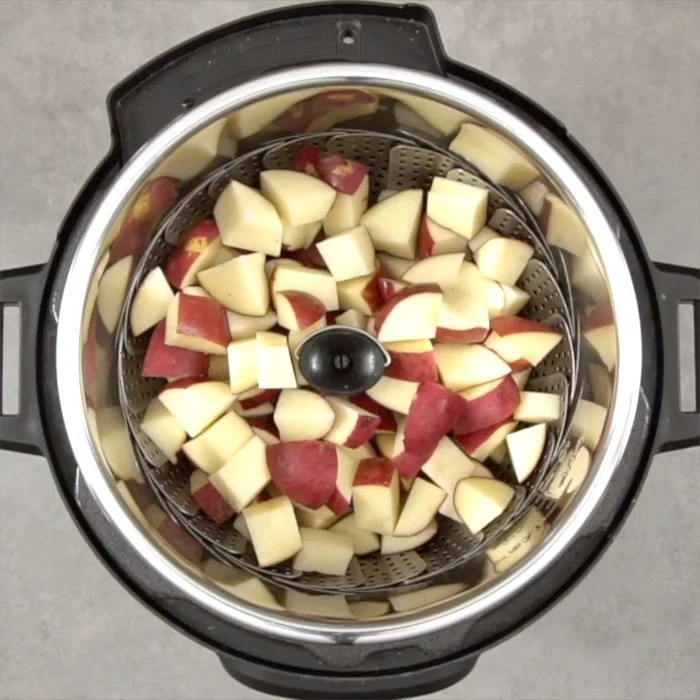 Red skin potatoes are steamed in the Instant Pot