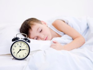 kid-sleeping-with-clock-showing-time-300x225 7 Natural Remedies for Winter that Work!