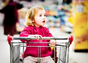 little-girl-in-grocery-cart-300x217 10 Tips To Raise Fit Kids Who Like To Eat REAL Healthy food!