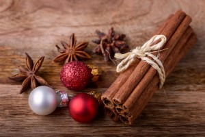 cinnamon and star anise with red and white christmas balls on wood