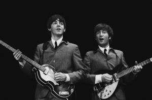 "This February 11, 1964 photo provided by Christie's auction house, from a collection of photos of The Beatles shot by photographer Mike Mitchell at the Washington Coliseum in Washington, D.C., shows Paul McCartney, left, and John Lennon during group's first US concert, two days after their Ed Sullivan appearance. The concert photos, taken when the photographer was just 18 years old, will be auctioned by Christie's in their sale ""The Beatles Illuminated: The Discovered Works of Mike Mitchell,"" in New York on July 20, 2011. (AP Photo/Christie's, Mike Mitchell)"