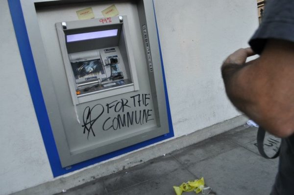 "Grafitti ""99%"" and ""For the Commune"" on vandalized bank ATM; 2011 Occupy"