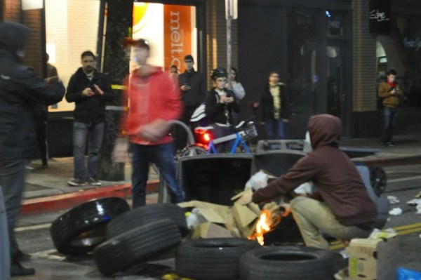 Rioters lighting fires in the streets of Berkeley, CA; 2014 Black Lives Matter