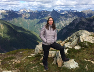 Erica Jones at high elevation, mountain ranges in background