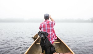 Topics to talking to girls about Man in boat with his dog