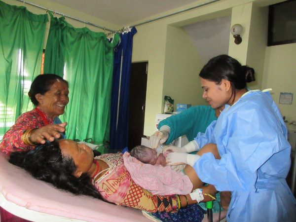 Anju Lama with her baby after giving birth