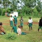 Schoolchildren Taking a Break on the Lawn