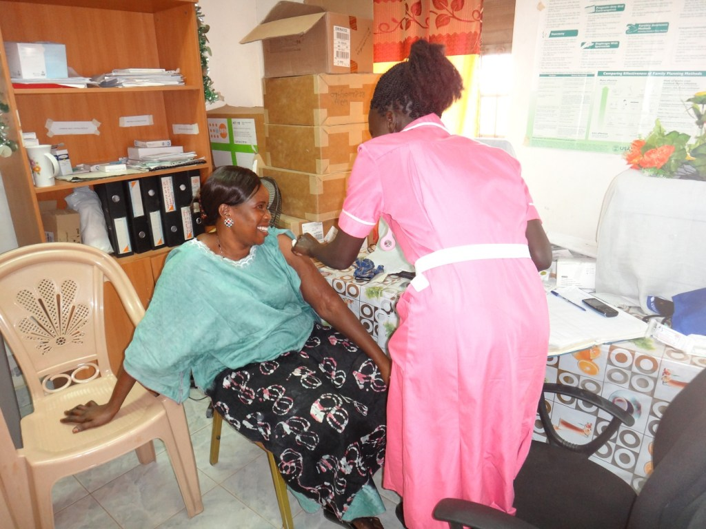 a second year midwifery student administering depo-provera
