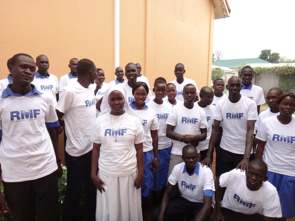 New first year nursing students pose for a group photo after receiving RMF t-shirts