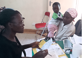 Mentor Mother Jane works with an HIV+ mother