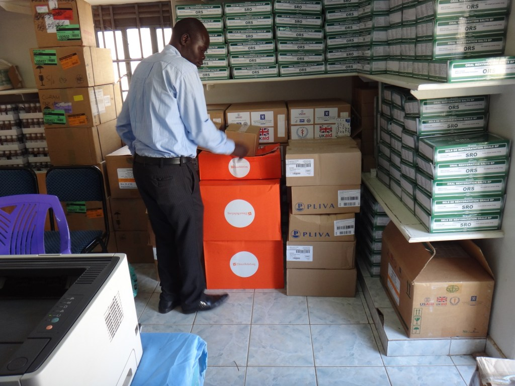 RMF's Wilson arranging the cartons in the drugstore
