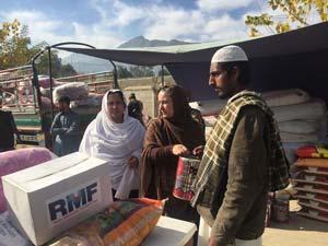 women and man receiving supplies