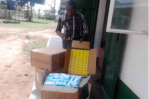 man unpacking a shipment of supplies