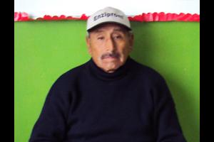 Peru man in black sitting on chair