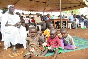 uganda children sitting on the ground
