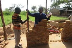 men laying bricks in africa