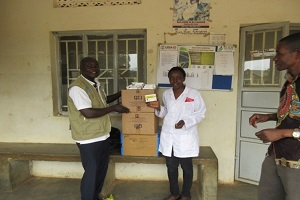 doctors pose with donation of medicine