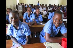 Ugandan students smiling in blue