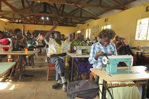 students learning sewing machines