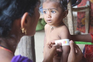 young girl receives malnutrition test