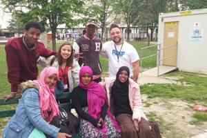 RMF staff with a group of newly arrived refugees from Africa