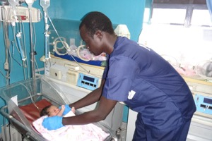 JCONAM student resuscitating a neonate following delivery