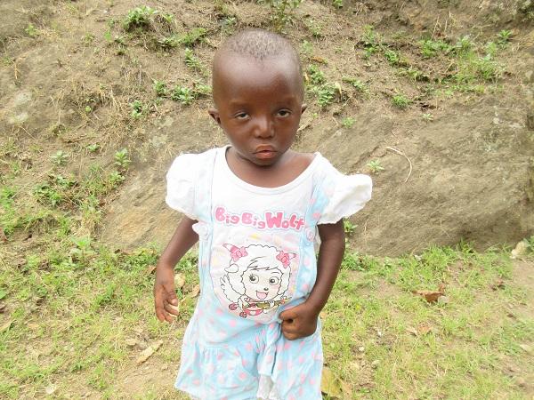 young girl in uganda seeking medical treatment