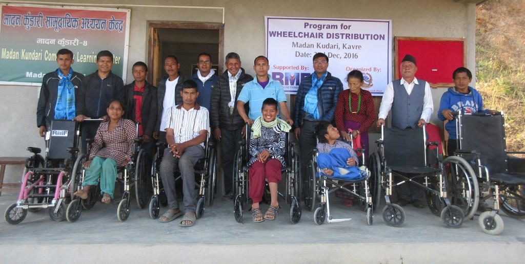 Beneficiaries of the wheelchair distribution program with their guardians, RMF's Ganesh Shrestha, and health post supervisors after the distribution program