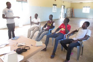 Geoffrey, RMF nutrition program manager, mentoring RMF nutrition staff members in Boma during  an M&E visit