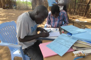 RMF nutrition team in Boma preparing a report at the end of a distribution day