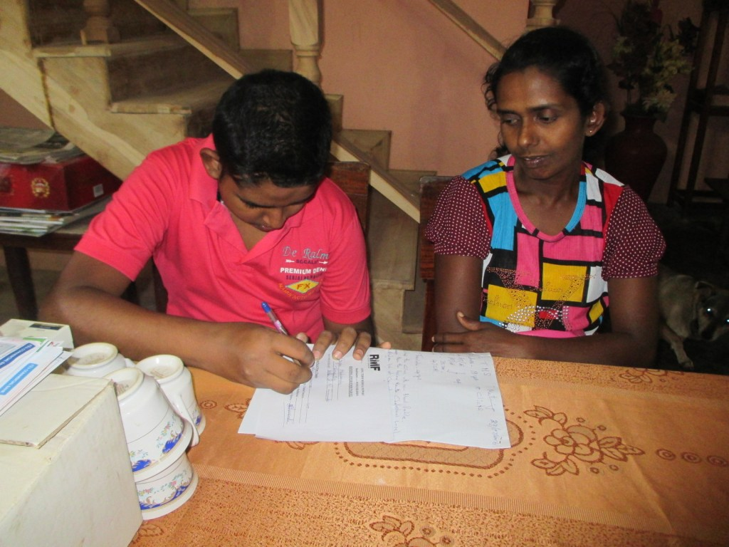 Gayan signs the document