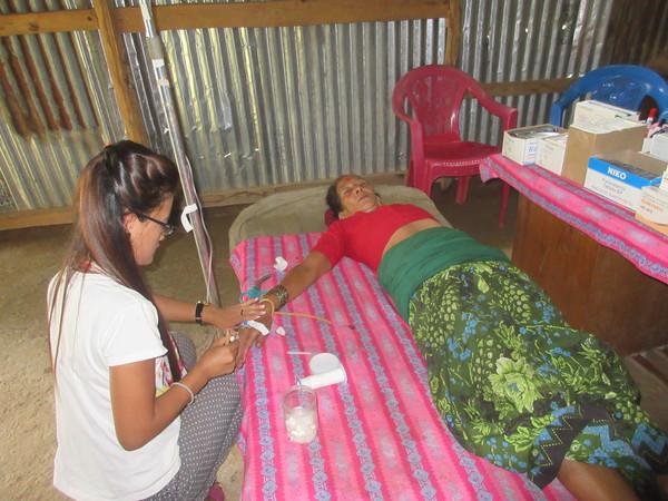 RMF clinician Laxmi inserting an IV
