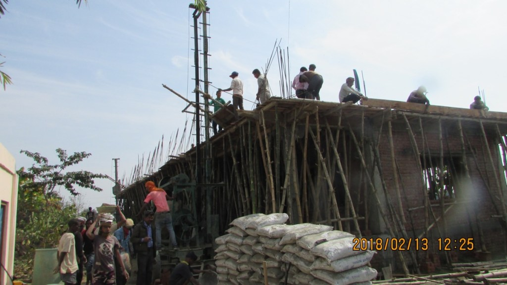 Workers carrying concrete to the roof