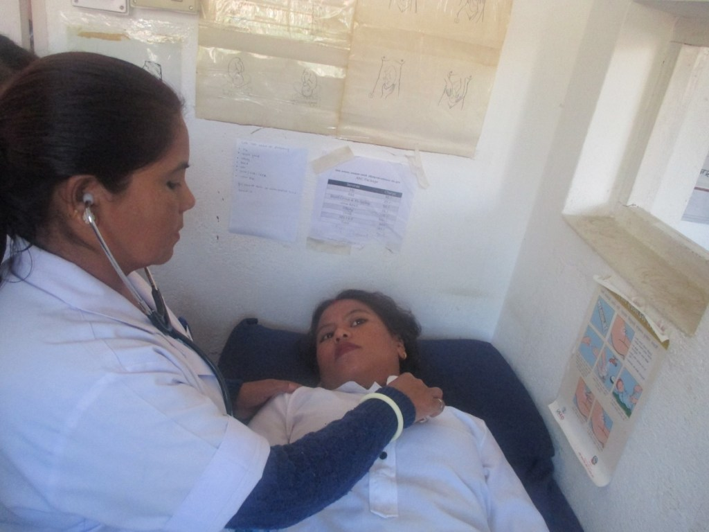 RMF Senior Registered Nurse examining Sabita during an ANC visit