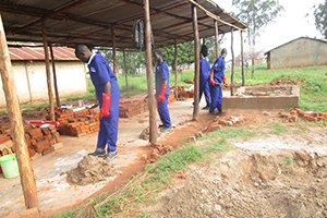 Students from Panyadoli Vocational Training Institute- Bricklaying and Concrete Practice working to build a structure