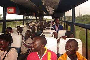 A soccer team rides a bus while traveling for a soccer match in Gulu, northern Uganda