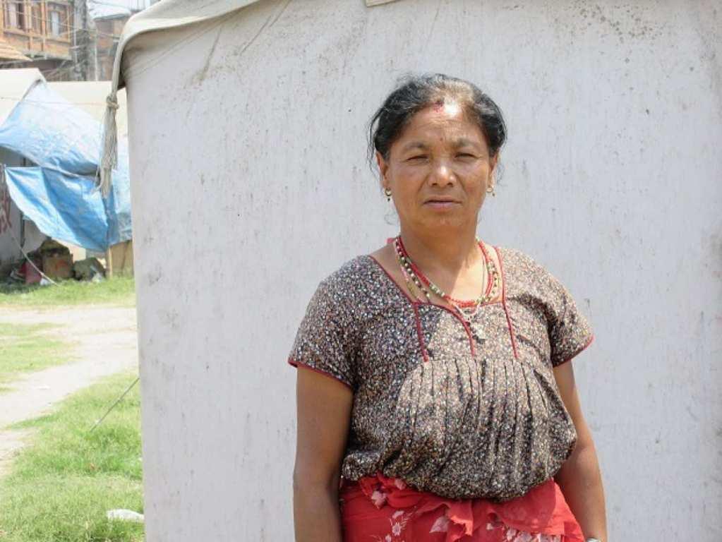 Juna Astamaya outside her tent