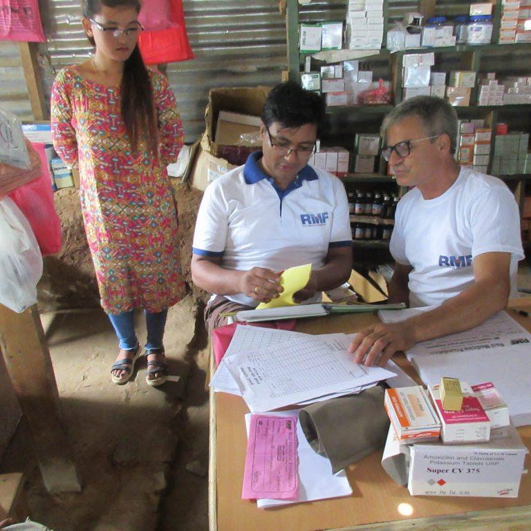 Program Manager Ganesh Shrestha (center) assessing clinic records