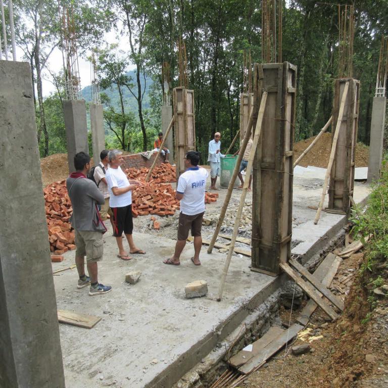 August 2018: Program Manager Ganesh Shrestha (right) assessing construction progress