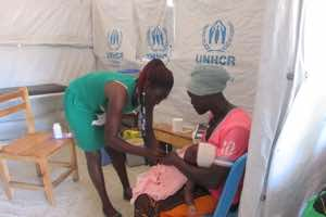 A nurse attending to a mother and her child at the EPI clinic. Immunization is one of the services offered at all our facilities. Mothers are encouraged to bring their children back to the facility for immunization as advised by the medical workers.