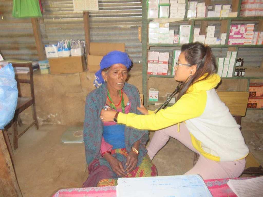 RMF Nurse Laxmi examining Purna