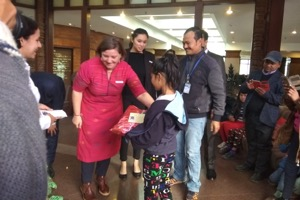 An NCO child receiving a gift at the Christmas celebration