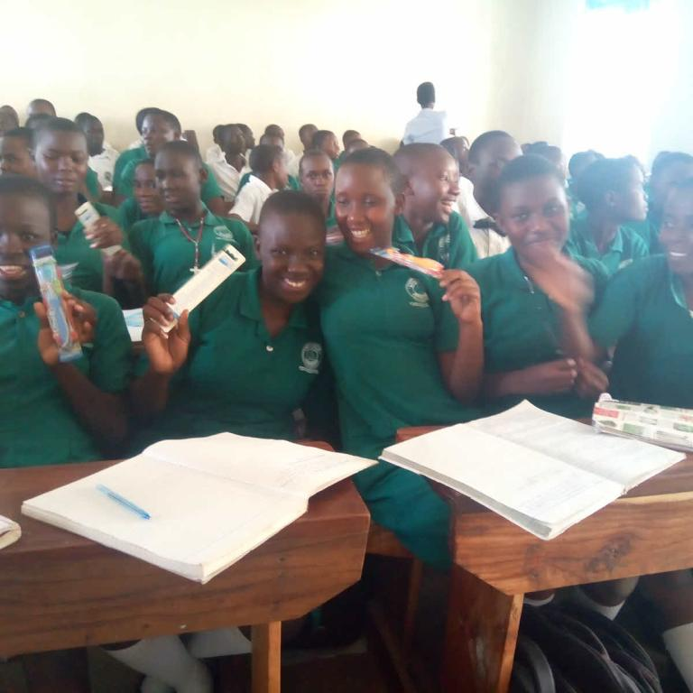 Students happily showing off their toothbrushes, received through RMF thanks to Direct Relief's in-kind donation